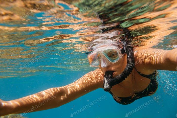 Woman snorkeling.