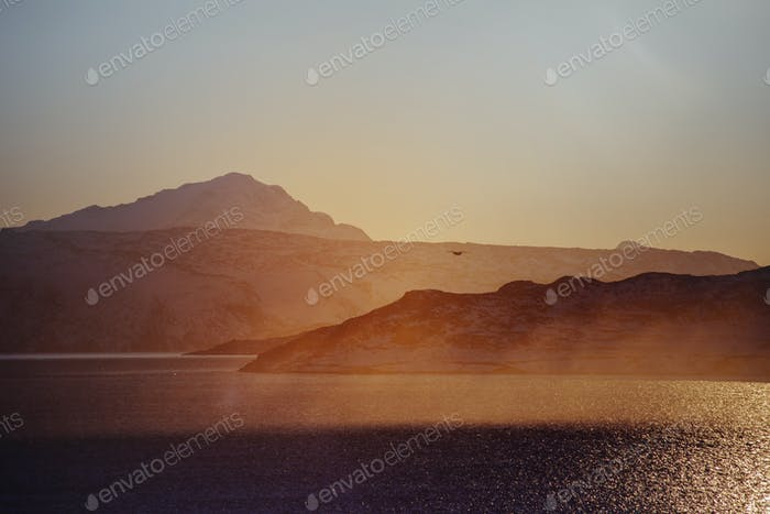 Scenics view of sea coastline at sunset