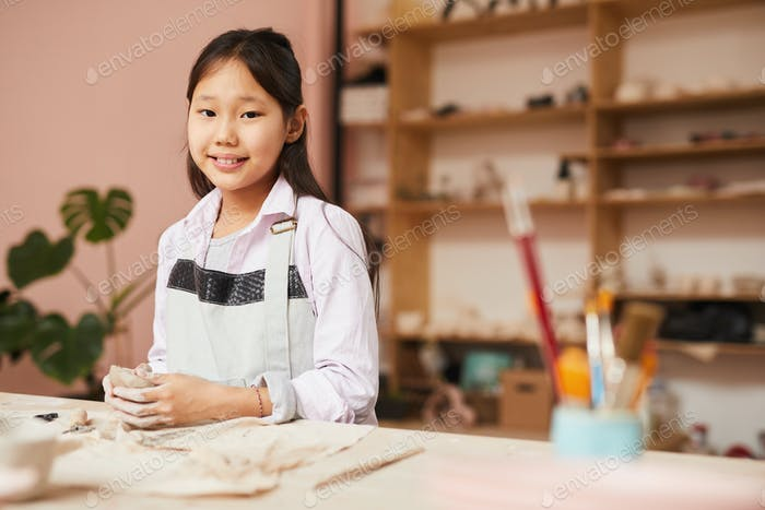 Happy Asian Girl in Pottery Class