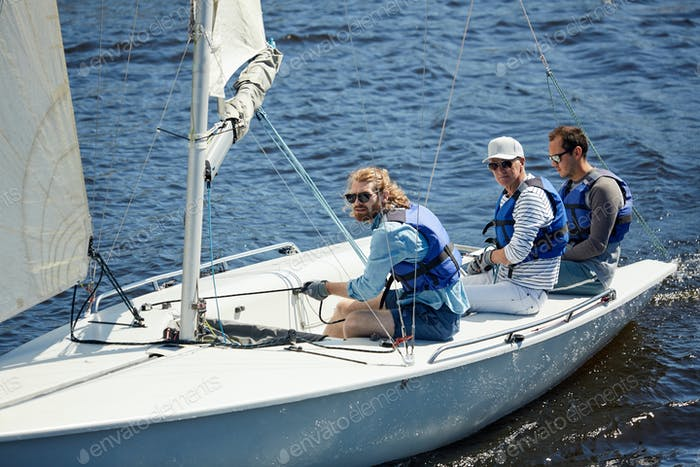 Serious men sailing on weekend