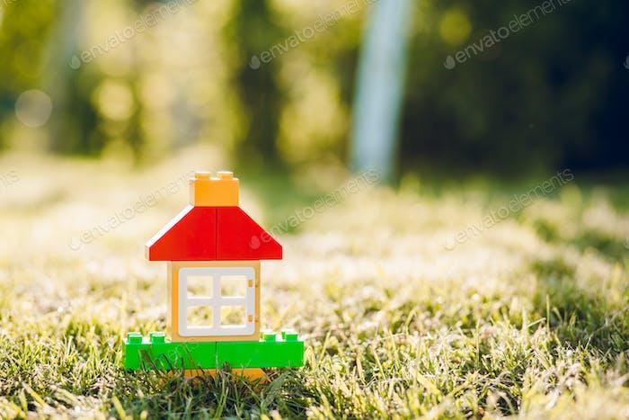 A toy house of little boy in summer garden.