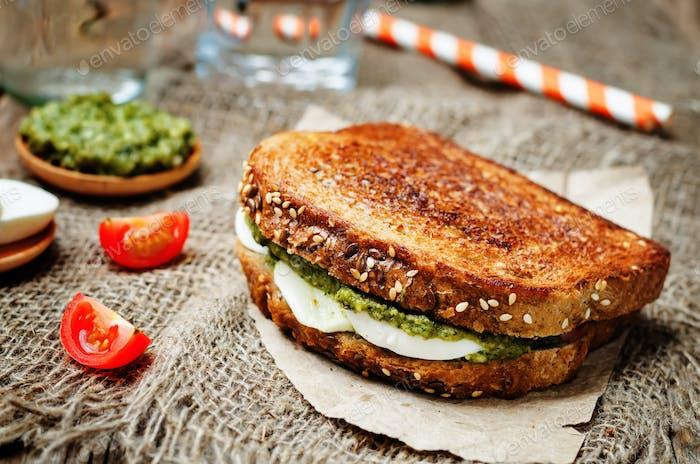 Pesto Mozzarella tomatoes grilled rye sandwich