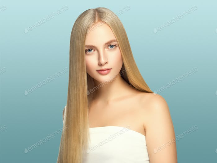 Smooth long blond hair woman natural make up healthy skin. On blue.
