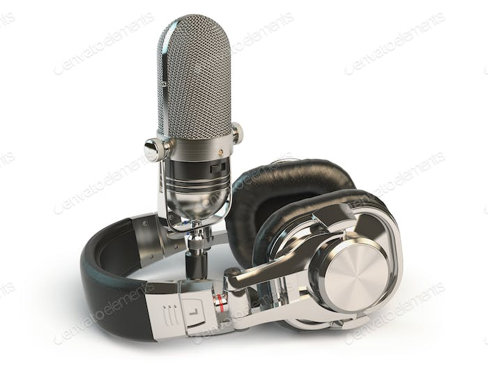 Microphone and headphones isolated on white. Audio recording or