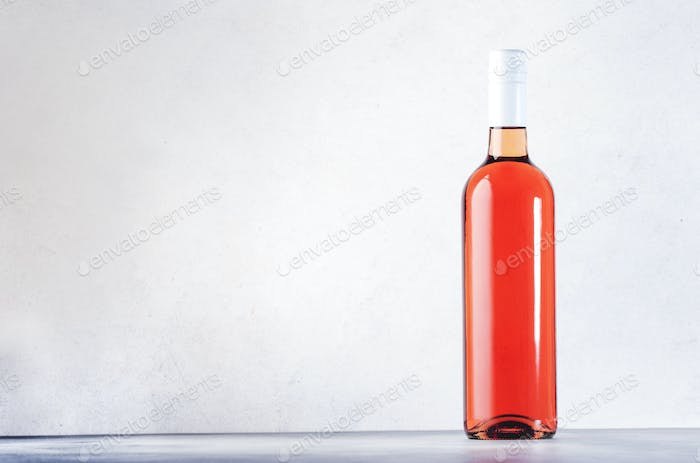 Rose wine bottle on the gray table. Pink rosado, rosato or blush wine