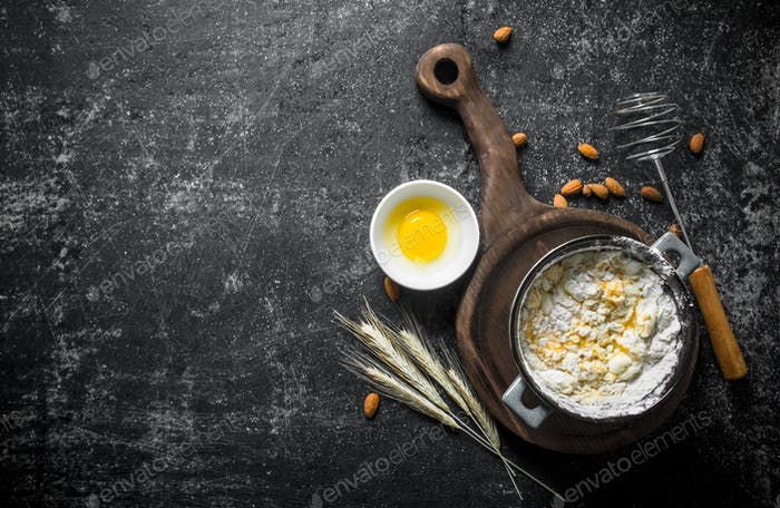 Baking background. Freshly prepared dough in a saucepan with egg and spikelets.