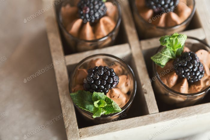 Delicious desserts with blackberry over wooden surface