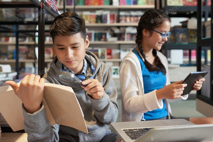 Smart kids spending time in school library