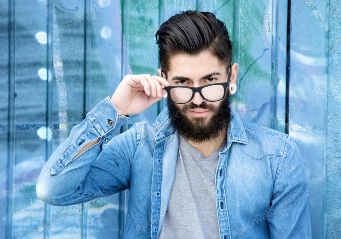 Modern man with beard and glasses