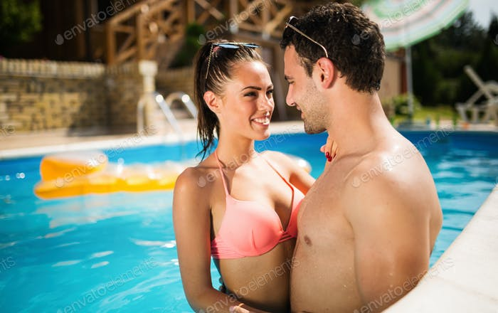 Beautiful couple in love enjoying summer resort