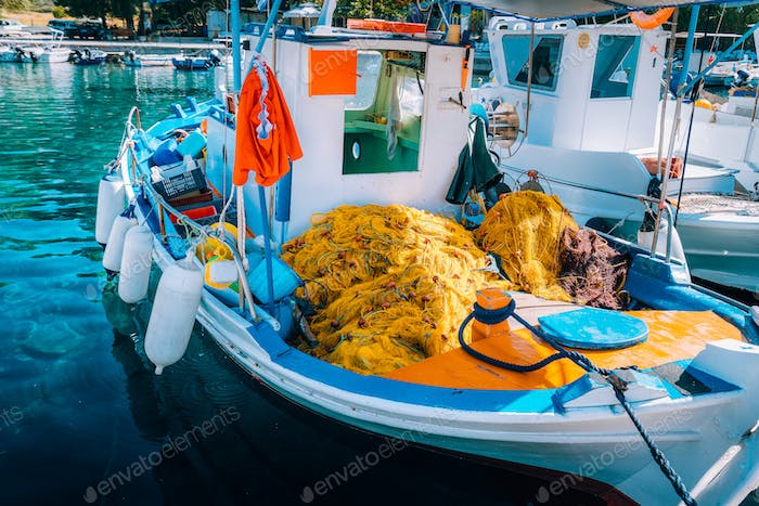 Traditional colorful fishing boat in the sea, Greece. Sunny summer day