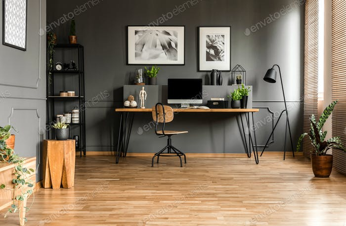 Real photo of spacious start-up office interior with a single ch