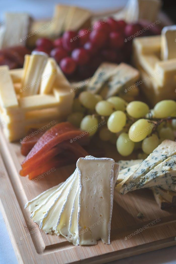 Cheese platter on a wooden desk