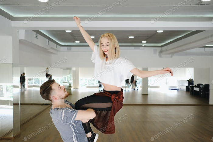 Man and woman performing acrobatic dance movements