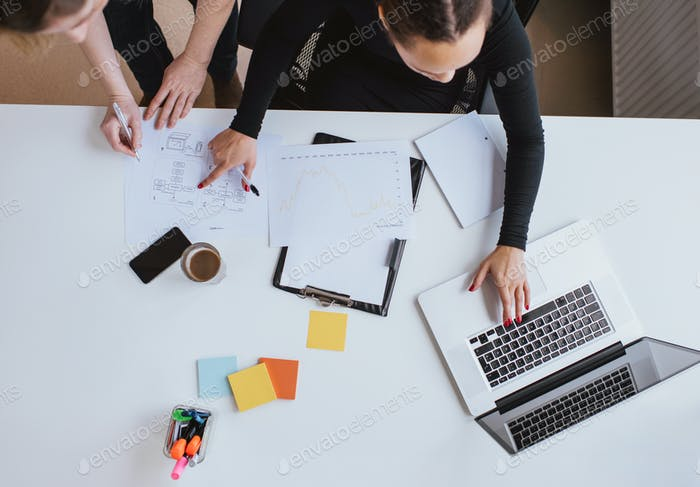 Business team working on a new plan with laptop