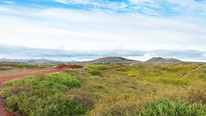 landscape with red volcanic soil in Iceland