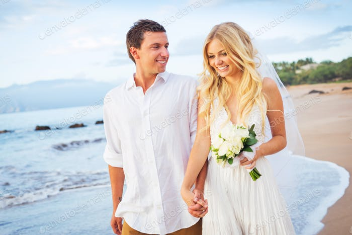 Bride and Groom Walking on Beautiful Tropical Beach at Sunset, R