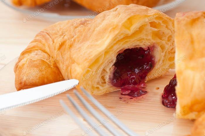 croissant French brioche filled with berries jam