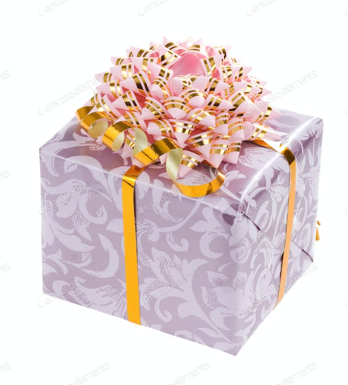 gift box with gold ribbon on white