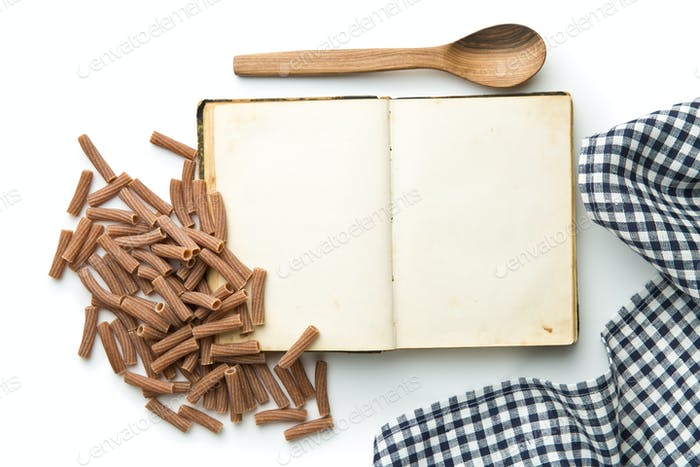 Blank recipe book and italian pasta.