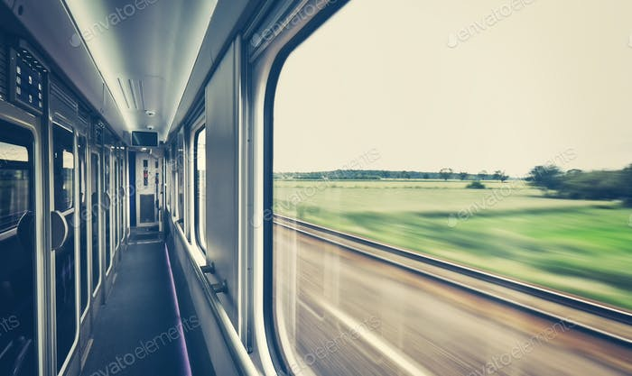Retro toned window of a train in motion.