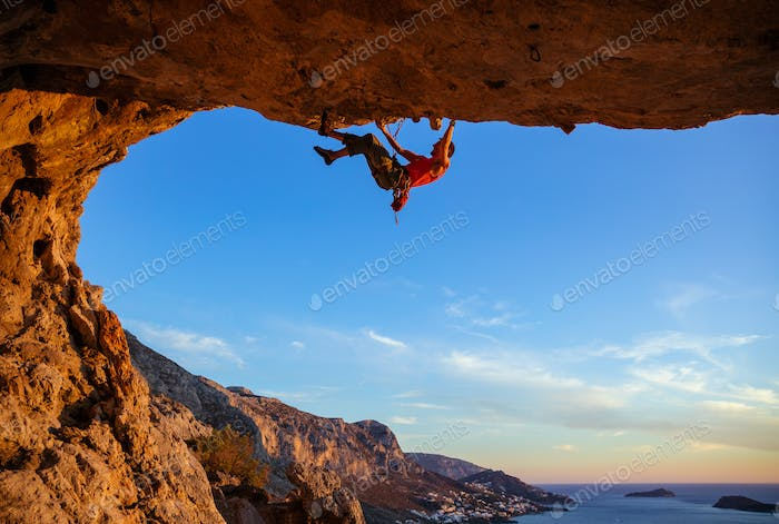 Young man climbing in cave
