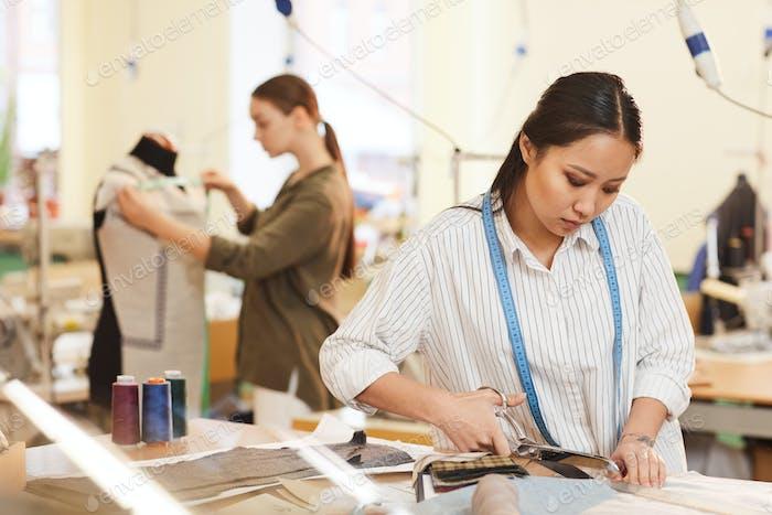 Designer working with scissors