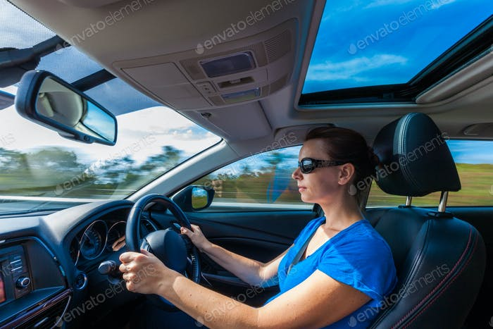 Your woman driving luxurious car on highway