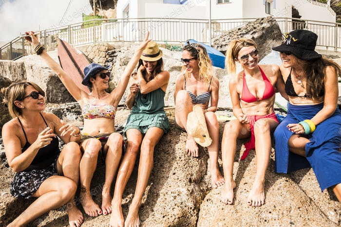 group of nice and beautiful friends smiling together having fun in friendship summer