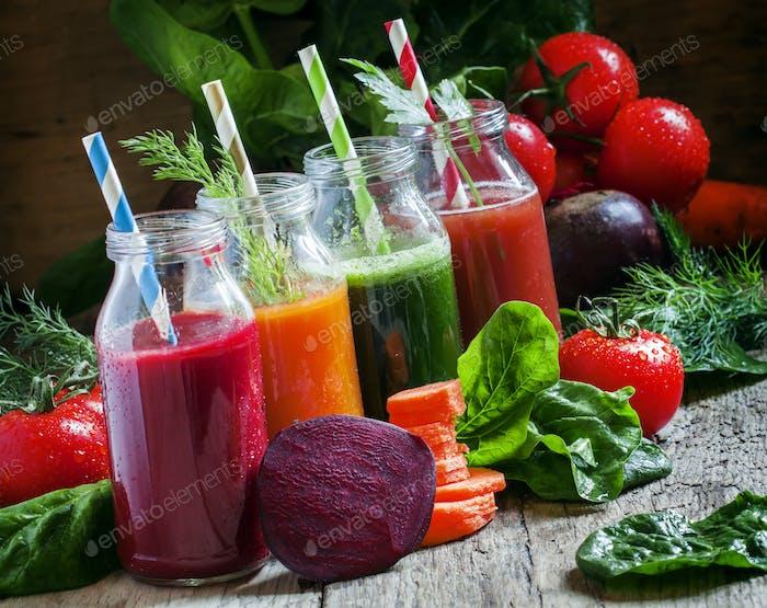 Freshly squeezed vegetable juice in bottles, useful vitamin cocktail