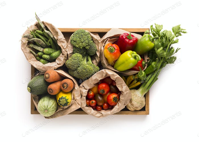 Fresh and healthy rich on vitamins fruits and vegetables in sacks