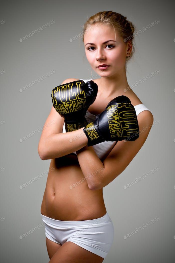 Cute caucasian slim girl boxer in white lingerie