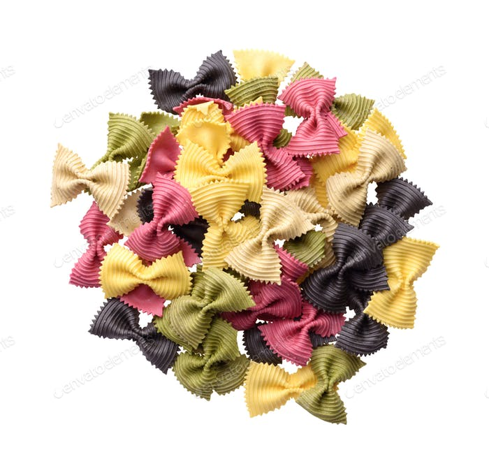 Heap of multicolor uncooked farfalle pasta