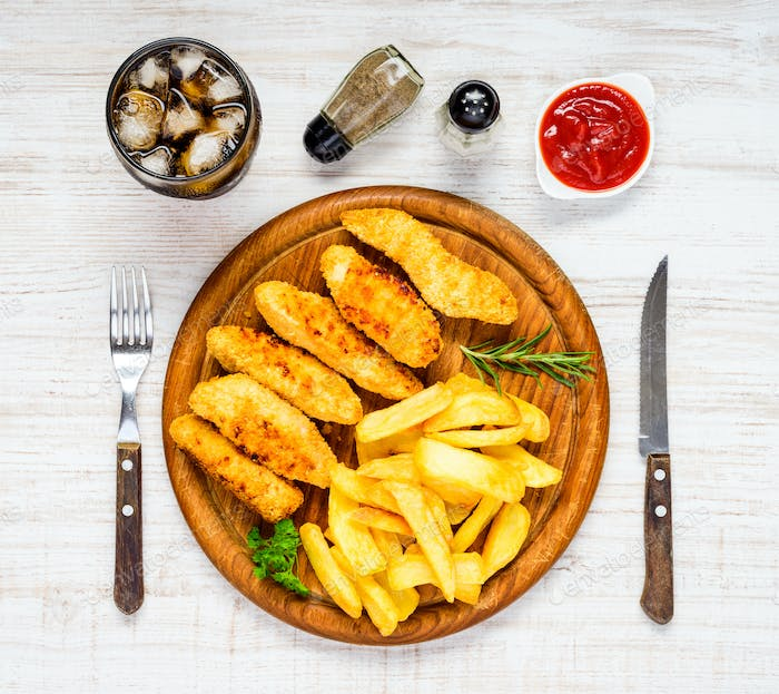 Fast Food with French Fries, Cola and Fish Nuggets