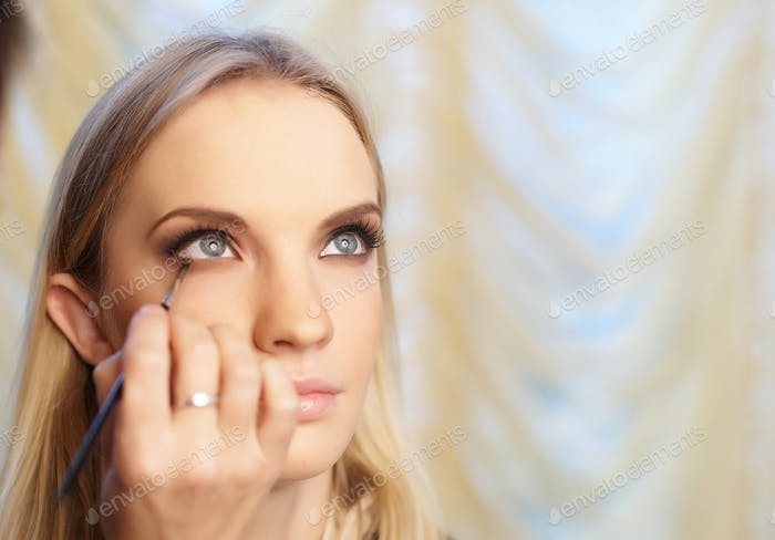 Woman face with make up.