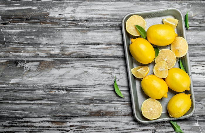 Juicy lemons on a baking sheet.