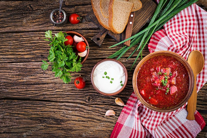Traditional Ukrainian Russian borscht or red soup in the  bowl. Top view