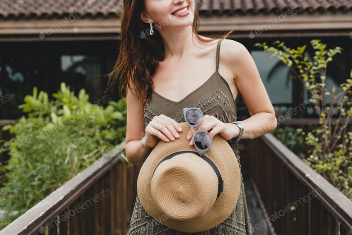portrait of young attractive woman in elegant dress, straw hat, summer style