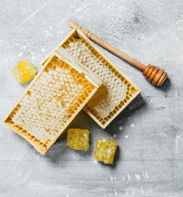 Honey in wooden honeycombs.