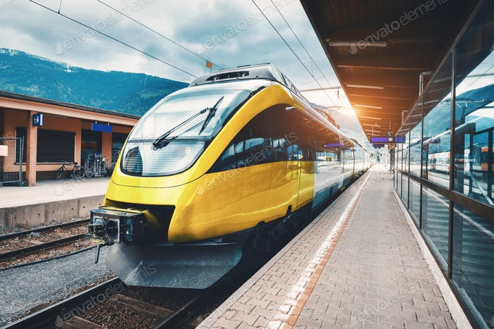 Beautiful high speed train on the railway station in mountains