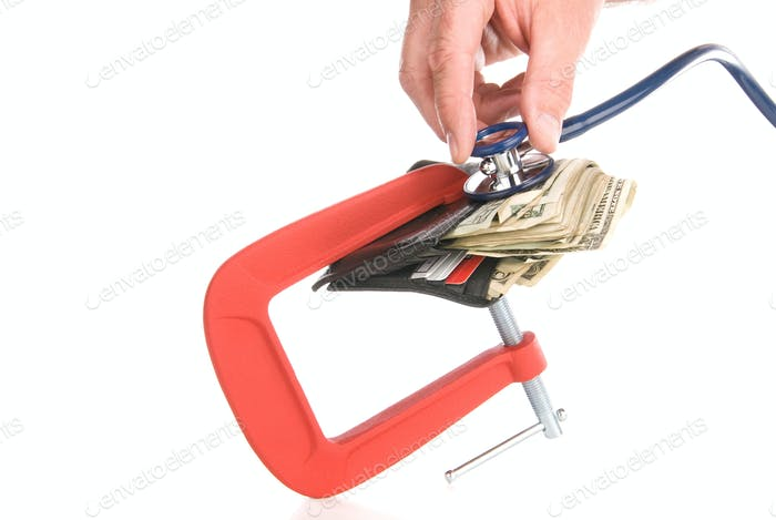 Clamped wallet examined with stethoscope