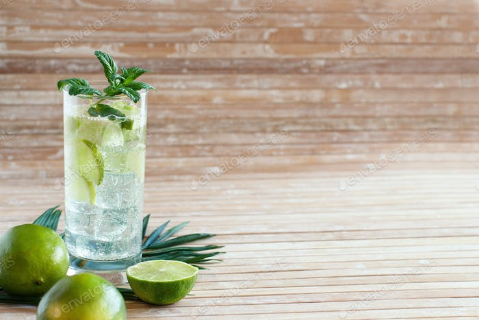 Homemade refreshing drink with lime juice and mint