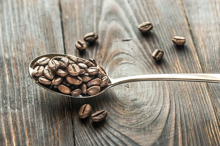 Spoon of coffee beans