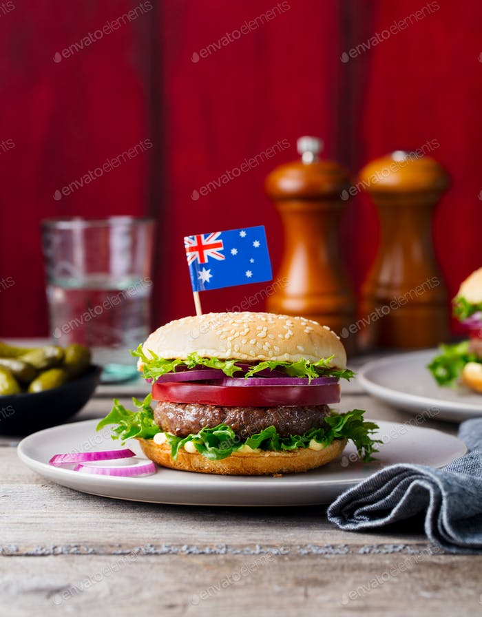 Burger with Australian Flag on Top. Wooden Background. Copy Space.