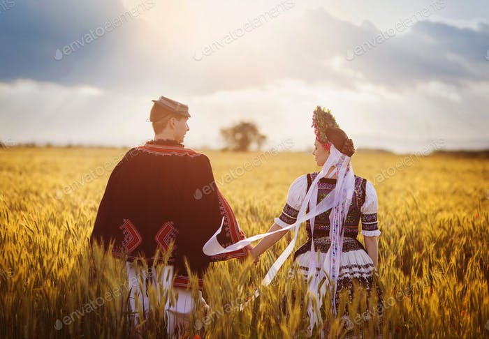 Couple in love with traditional folk costumes