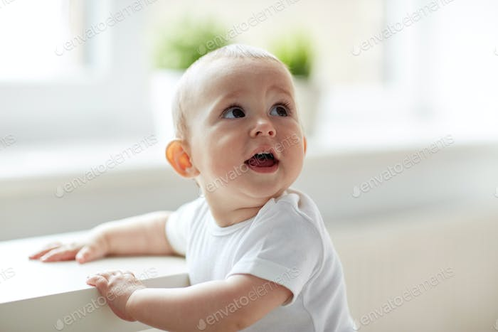 happy little baby boy or girl at home