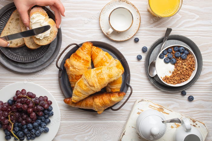 Traditional morning breakfast food on rustic white wooden background