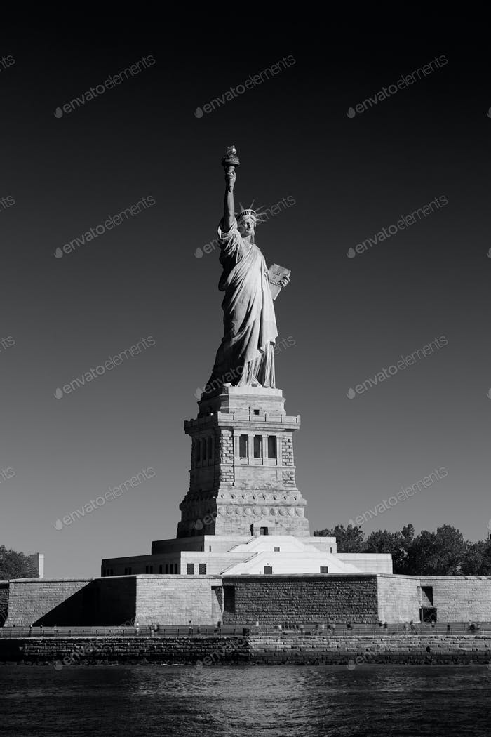 Statue of Liberty and Liberty Island in a sunny day, New York