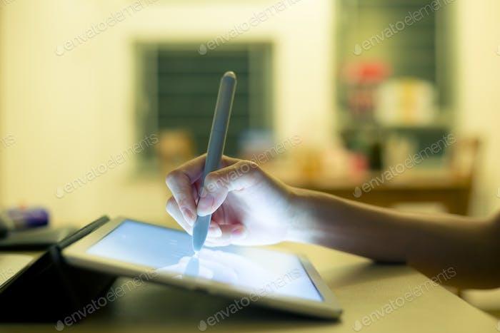 Woman drafting design on digital tablet