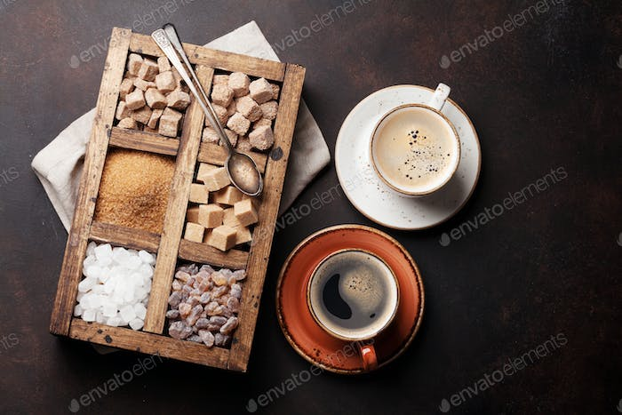 Coffee cups and various brown sugar